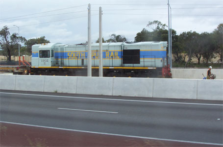 South Spur Line diesel freight engine sitting in the Kwinana Freeway median near Murdoch station