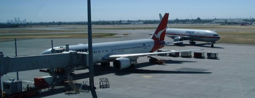 [Qantas and Malaysia Airlines planes at Perth Airport]
