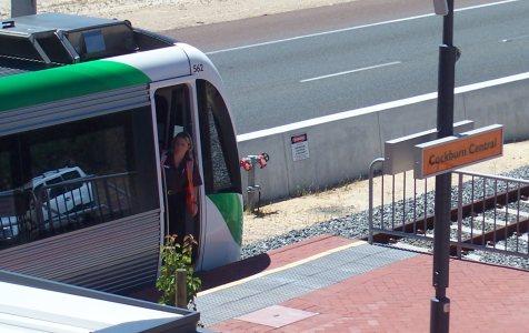 Train driver looking along the platform at Cockburn Central